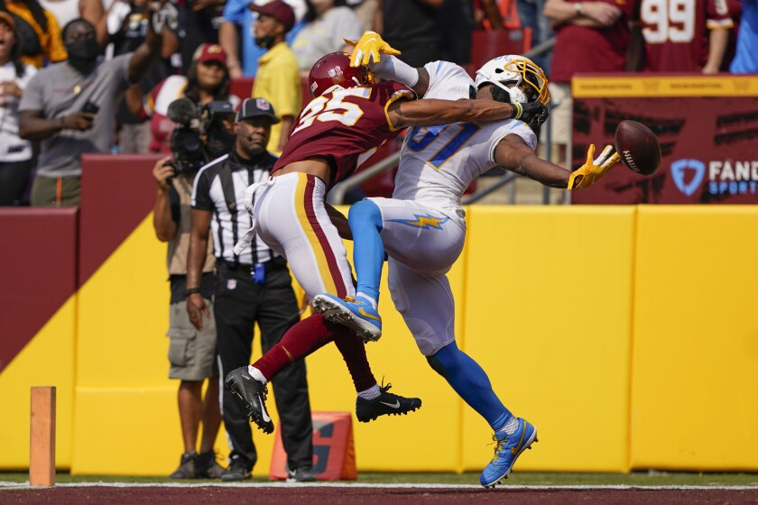 Washington Football Team cornerback Benjamin St-Juste (25) breaks up pass for Los Angeles Chargers wide receiver Mike Williams (81) during the second half of an NFL football game, Sunday, Sept. 12, 2021, in Landover, Md. (AP Photo/Andrew Harnik)