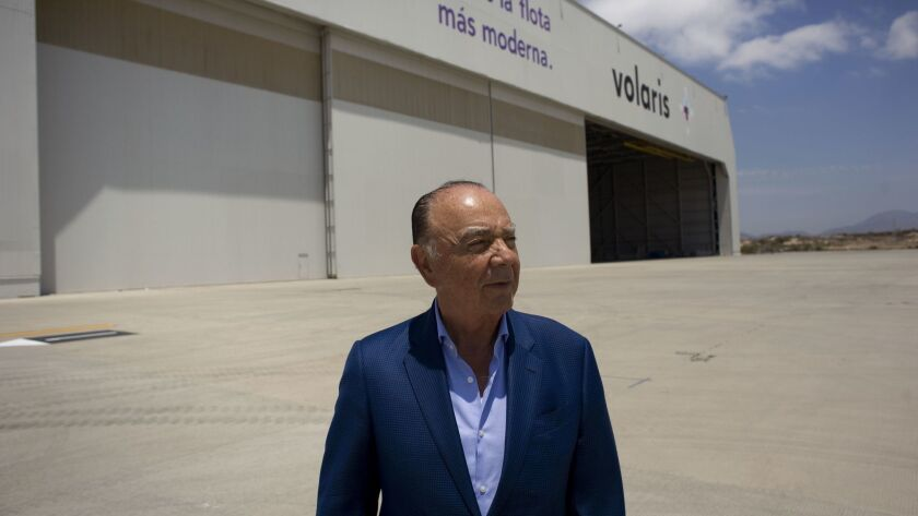 Businessman Carlos Bustamante, a former Tijuana mayor, standing last week outside a converted airplane repair hangar where he is preparing today to launch an air cargo and logistics park.
