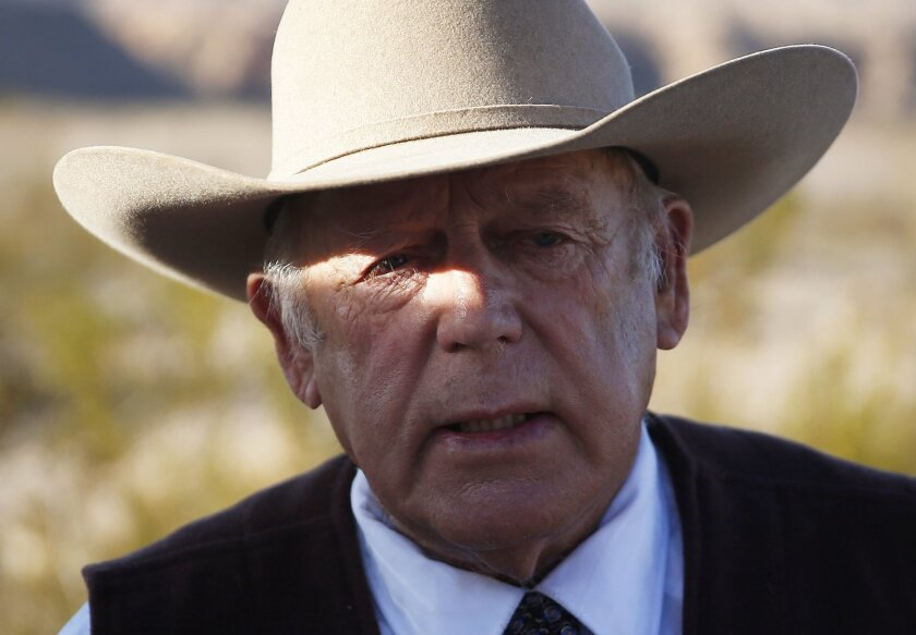 FILE - In a Wednesday, Jan. 27, 2016 file photo, rancher Cliven Bundy speaks to media while standing along the road near his ranch, in Bunkerville, Nev. A federal grand jury in Nevada indicted Cliven Bundy and four others Wednesday, Feb. 17, 2016, on 16 charges related to an armed standoff near his