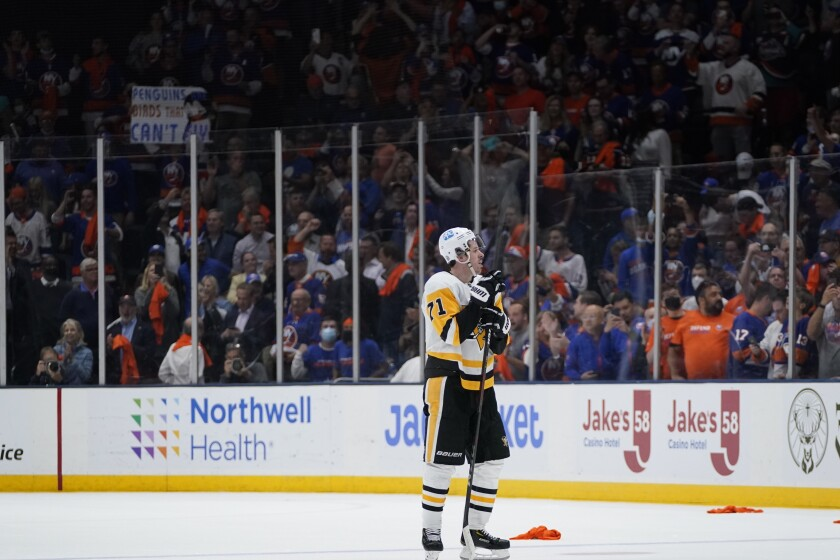 Pittsburgh Penguins' Evgeni Malkin (71) reacts after Game 6 of an NHL hockey Stanley Cup first-round playoff series against the New York Islanders, Wednesday, May 26, 2021, in Uniondale, N.Y. The Islanders won 5-3. (AP Photo/Frank Franklin II)