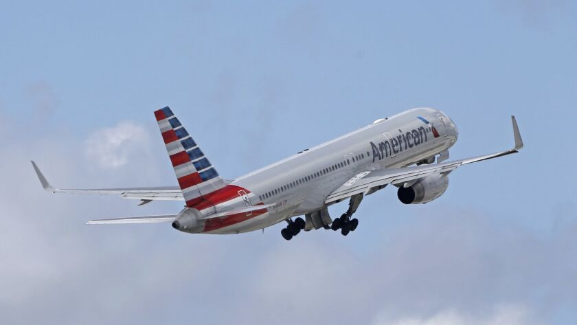 An American Airlines passenger jet takes off from Miami International Airport. American Airlines has agreed to pay $45 million to settle an antitrust lawsuit that claimed several airlines colluded to keep capacity low. The airline denies the charge.