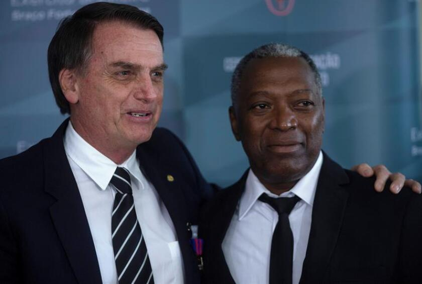 Brazilian President-elect Jair Bolsonaro (L) was awarded the Peacemaker Medal with Full Palm in a closed-door ceremony for an act that took place in the 1970s, when he jumped into a lagoon to rescue a fellow soldier, identified as Celso Negao (R), who had fallen into the water and did not know how to swim. Bolsano at the time was part of an artillery and paratroop company based in Rio de Janeiro. Brasilia, Brazil, Dec. 5, 2018. EPA-EFE/Joedson Alves.