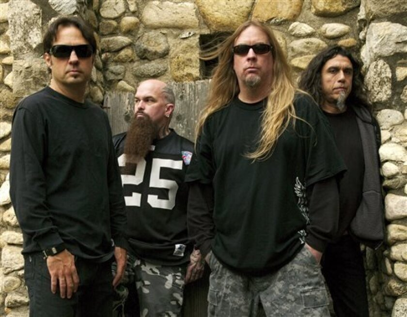 This 2009 publicity photo provided courtesy of Slayer shows, from left, Dave Lombardo, Kerry King, Jeff Hanneman and Tom Araya. Hanneman, 49, died May 2, 2013, of liver failure at a Los Angeles hospital with his wife, Kathy, by his side. It was initially theorized that Hanneman's death might have had something to do with a suspected spider bite that led to a case of necrotizing fasciitis, nearly costing him his arm. Members of Slayer say Hanneman died of alcohol-related cirrhosis. (AP Photo/Cour