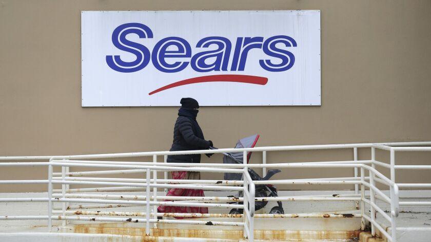A person walks near a Sears store in Hackensack, N.J.