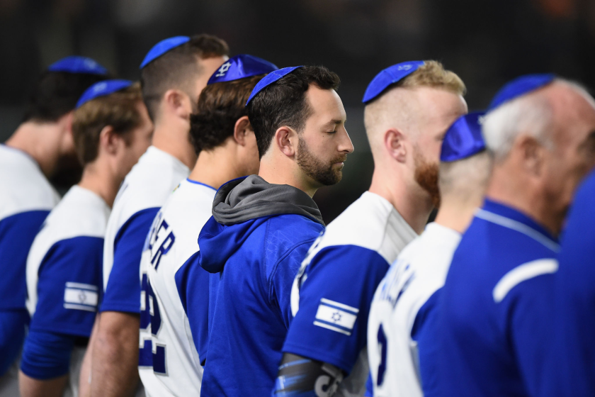 Israel players line up for the national anthem before a game in the World Baseball Classic.