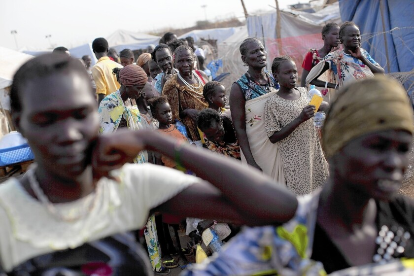 Displaced people wait for food in Juba, South Sudan, where ethnic violence has brought widespread upheaval less than three years after the country gained independence.