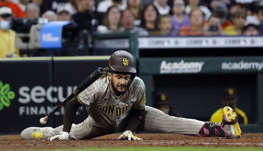 Fernando Tatis Jr. avoids being hit by a pitch in Houston on Saturday.