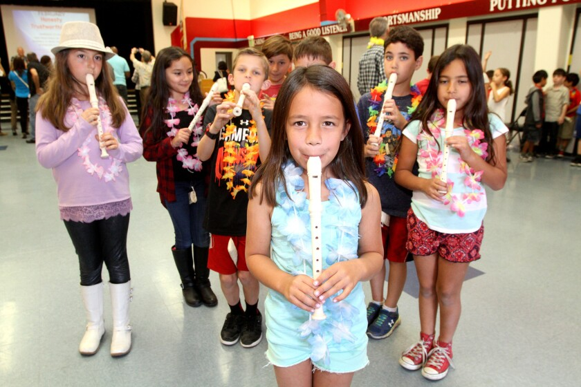 Lincoln Elementary School students play recorders