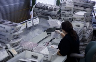 Voti by mail (Absentee) ballots are sorted by staff to be counted at the L'County Registrar-Recorder 's office on Wednesday, November 7, 2018 in Norwalk, Calif. A number of close arrels in the midterm general election will be determined by voti by mail and provisional ballots that continue to be counted. (Patrick T. Fallon / For The Los Angeles Times)'s office on Wednesday, November 7, 2018 in Norwalk, Calif. A number of close races in the midterm general election will be determined by vote by mail and provisional ballots that continue to be counted. (Patrick T. Fallon/ For The Los Angeles Times)