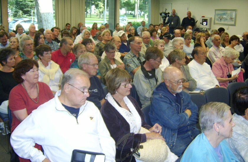 Coronado residents gather Wednesday at a town hall meeting in the Winn Room of the library to talk about traffic issues.