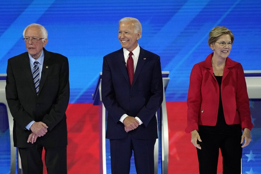 From left, presidential candidates Sen. Bernie Sanders of Vermont, former Vice President Joe Biden and Sen. Elizabeth Warren of Massachusetts participate in September's Democratic primary debate in Houston.