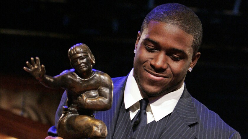 "Former USC running back Reggie Bush forfeited his Heisman Trophy award after admitting to making ""mistakes"" during his time with the Trojans."