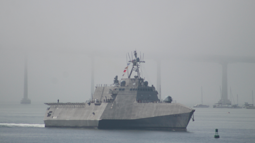 The littoral combat ship Gabrielle Giffords slowly sails up San Diego Bay in the early morning mist.