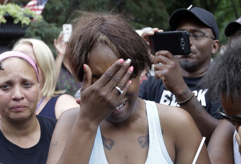 Diamond Reynolds, the girlfriend of Philando Castile, cries outside the governor's residence in St. Paul, Minn.