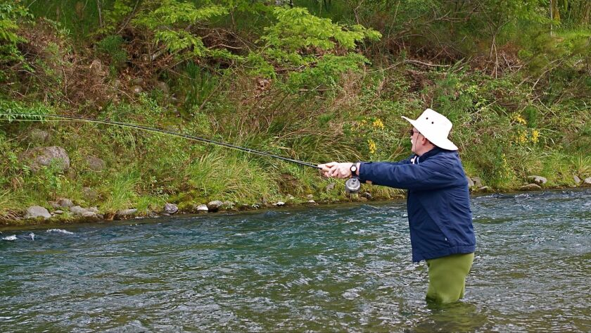 Bill Heard casts a line into the swift-flowing Tongariro River in Turangi.