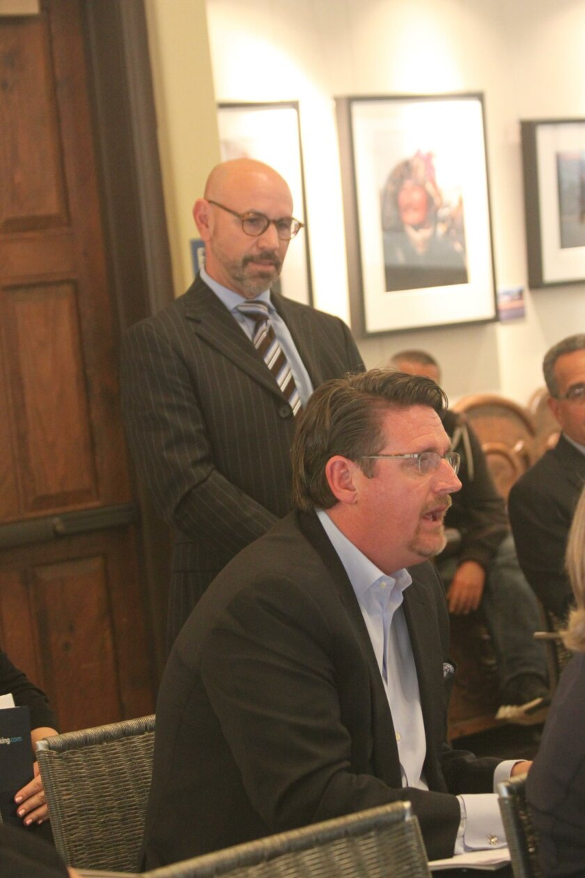 John Lambeth (seated) shares expertise on developing a MAD, while March Dibella (standing) listens.