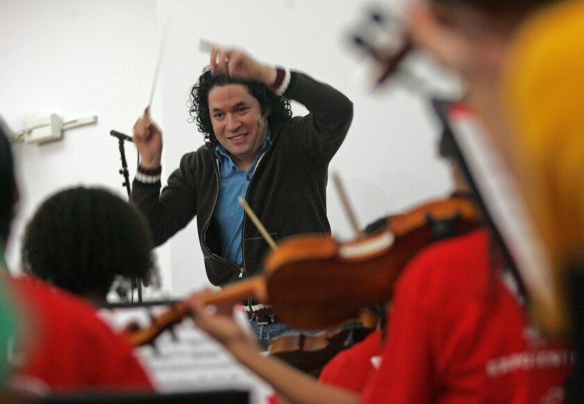 FILE - In this Oct. 29, 2011 file photo, conductor Gustavo Dudamel rehearses the Youth Orchestra of Los Angeles at YOLA EXPO Center Chamber Orchestra in Choral Hall at Walt Disney Concert Hall in Los Angeles. (AP Photo/Ringo H.W. Chiu, File)