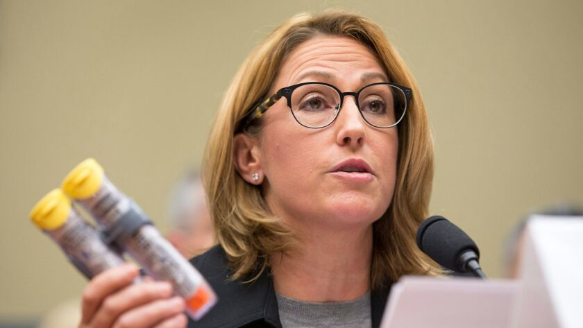epa05551114 Mylan Inc. CEO Heather Bresch holds up an EpiPens at the House Oversight and Government