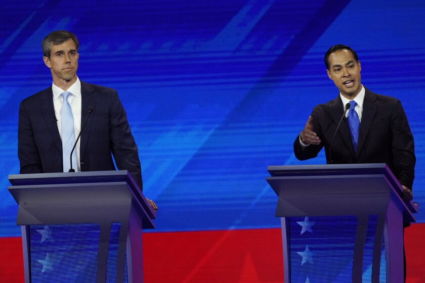 Former Texas Rep. Beto O'Rourke, left, listens as former Housing and Urban Development Secretary Julián Castro answers a question during the Democratic presidential primary debate in Houston.