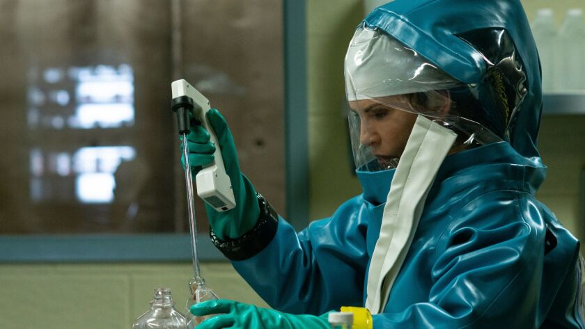 """Dr. Nancy Jaax (Julianna Margulies) works in her pathology lab in a scene from the National Geographic biohazard drama, """"The Hot Zone."""""""