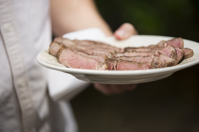 A plate of just-grilled steak is served at Curtis Stone's test kitchen in Beverly Hills.