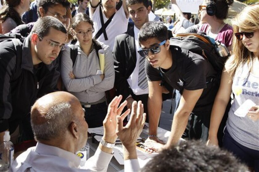 A student, right, argues with former University of California Regent Ward Connerly during a bake sale led by the Berkeley College Republicans Tuesday, Sept. 27, 2011, at the University of California campus in Berkeley, Calif. The Berkeley College Republicans have scheduled a bake sale where the pri