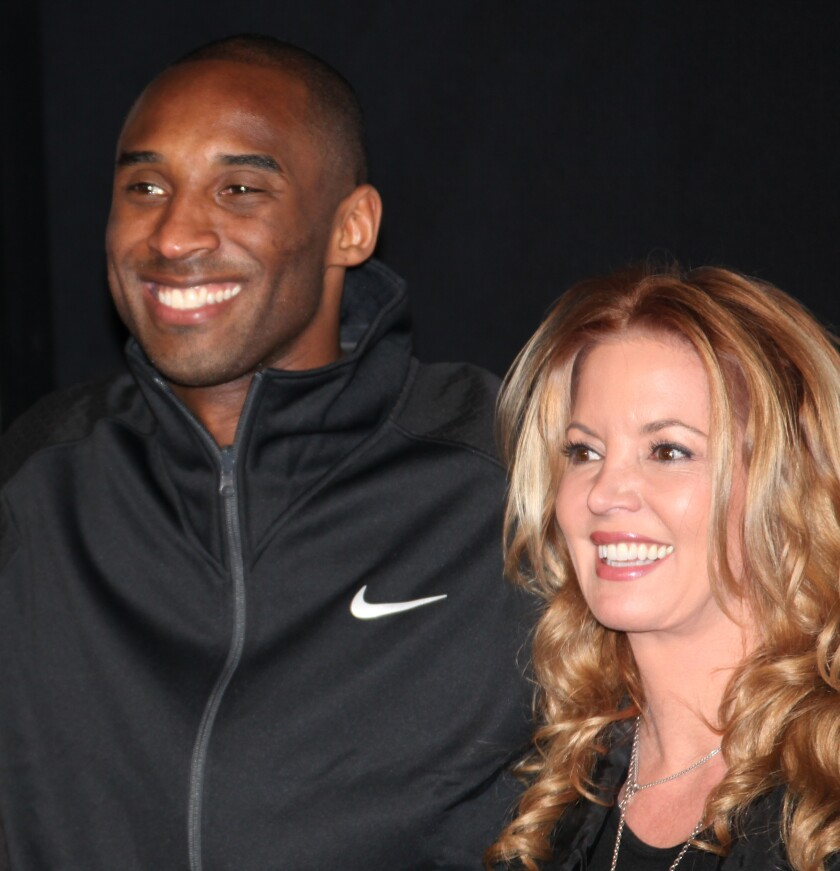 Kobe Bryant and Jeanie Buss attend his hand and footprint ceremony at Grauman's Chinese Theater in 2011.