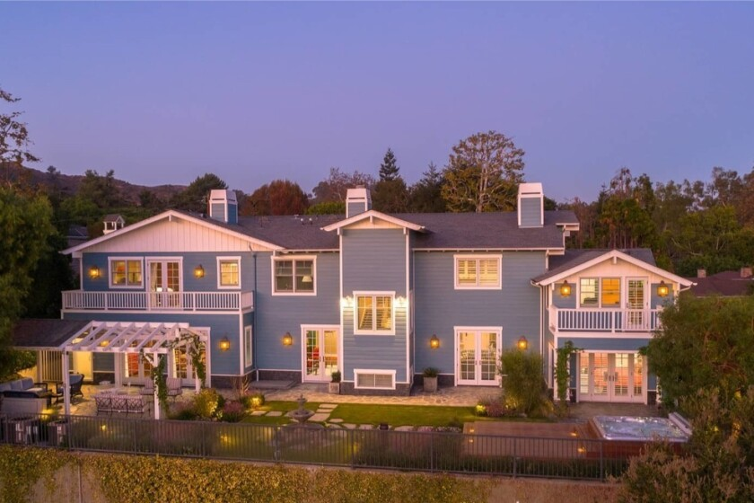 The three-story home sits on an ocean-view knoll near Will Rogers State Historic Park.