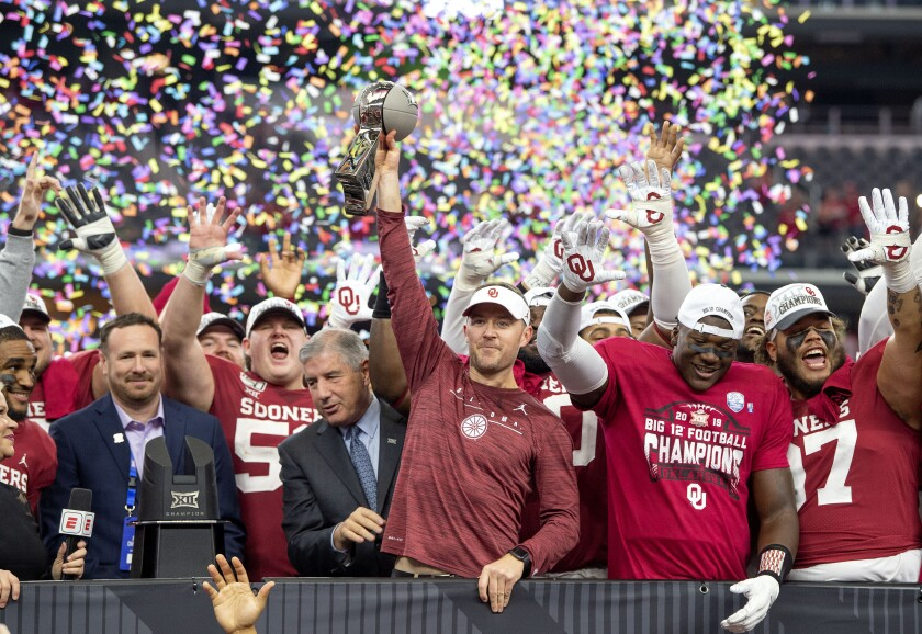 Oklahoma coach Lincoln Riley hoists the Big 12 championship trophy after the Sooners beat Baylor 30-23 on Dec. 7, 2019.
