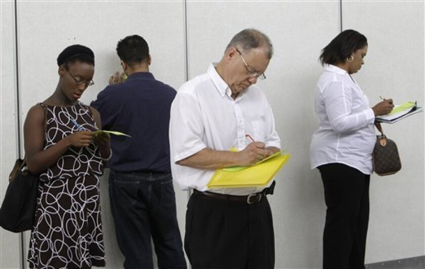 In this Aug. 25, 2010 photograph, job seekers including Pat Mosher, third from left, fill out registration forms to attend a job fair in Southfield, Mich. On Friday, Sept. 3, 2010, at 8:30 a.m. EDT, the Labor Department issues the August unemployment report. (AP Photo/Paul Sancya)