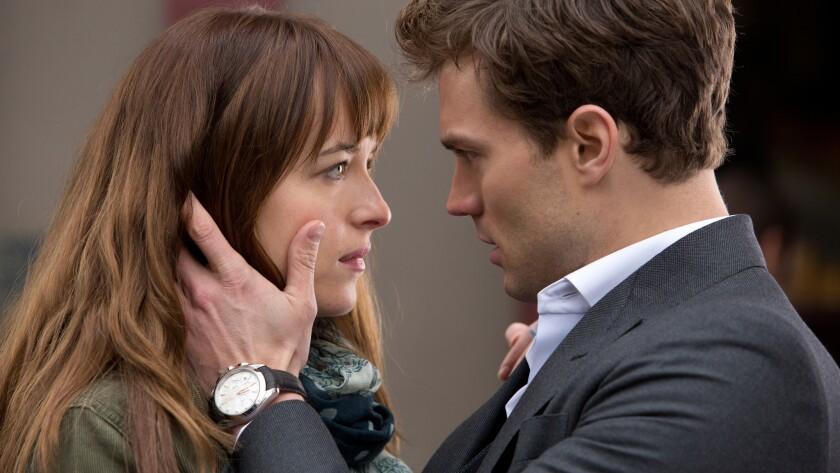 "Dakota Johnson and Jamie Dornan in the film adaptation of ""Fifty Shades of Grey."""