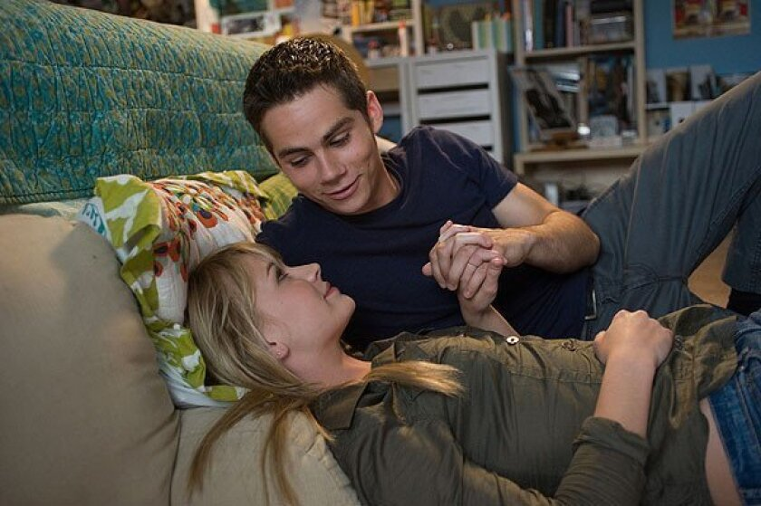 """Dylan O'Brien as Dave Hodgman and Britt Robertson as Aubrey Miller in """"The First Time."""""""