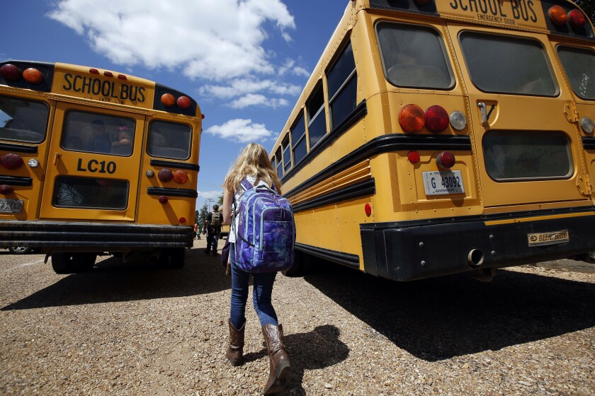 FILE - In this Aug. 13, 2014, file photo, a student prepares to leave the Enterprise Attendance Center school southeast of Brookhaven Miss. The federal government has decided to delay changing the way it determines funding for rural education after a bipartisan group of lawmakers said the move would hurt hundreds of schools. (AP Photo/Rogelio V. Solis, File)