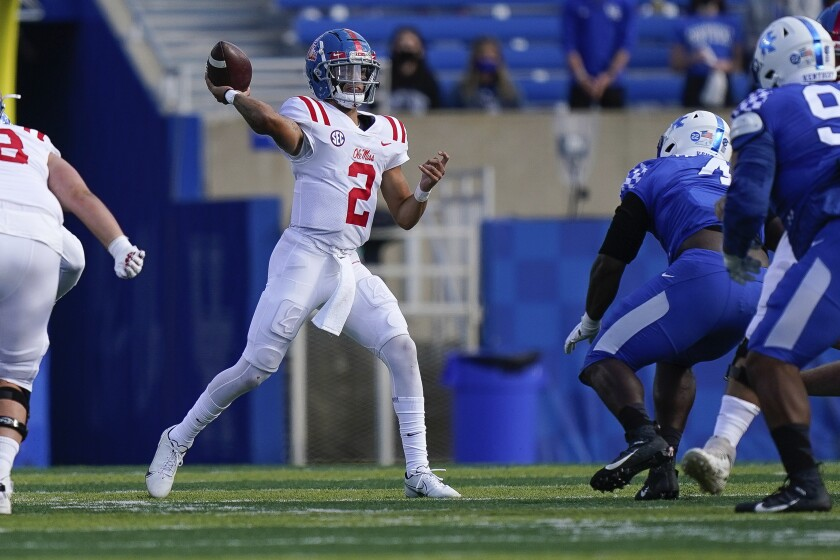 Mississippi quarterback Matt Corral (2) throws the ball during the first half of an NCAA college football game against Kentucky, Saturday, Oct. 3, 2020, in Lexington, Ky. (AP Photo/Bryan Woolston)