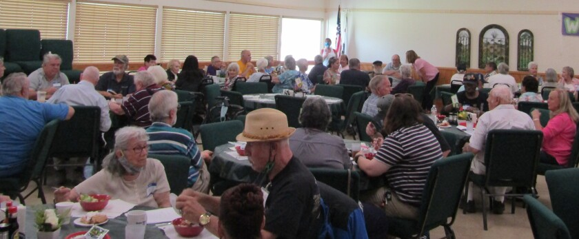 Seniors gather in a dining room that was 83 degrees on Tuesday because two air-conditioning units were not working properly.