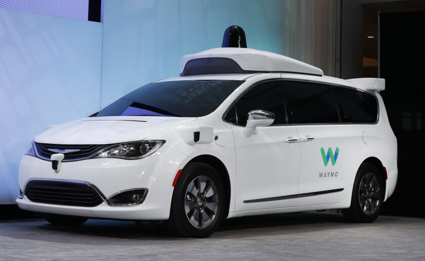 FILE - In this Jan. 8, 2017, file photo a Chrysler Pacifica hybrid outfitted with Waymo's suite of sensors and radar is displayed at the North American International Auto Show in Detroit. Right now, there is no car on sale that can drive itself without requiring the driver to pay attention to the road and be prepared to take control of the vehicle. In fact, some automakers have slowed down their timelines. (AP Photo/Paul Sancya, File)