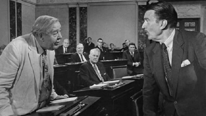 "Charles Laughton, left, as Sen. ""Seab"" Cooley, tells Senate Majority Leader Bob Munson (Walter Pidgeon) that he's going to bury his nominee for secretary of State."