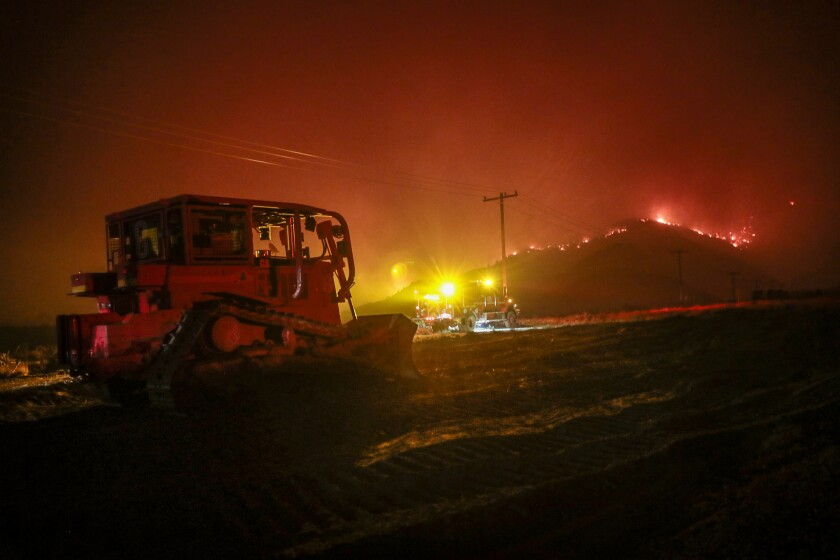 Flames crest a hill a few miles from Juniper Hills Road as the Bobcat fire advances north into the Antelope Valley.