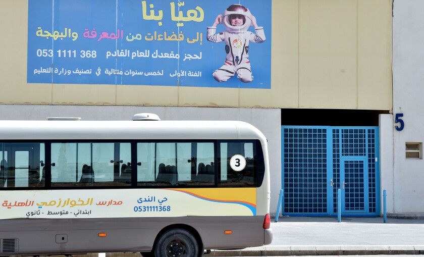 A bus is parked outside a closed private school in Riyadh, Saudi Arabia, on March 9.