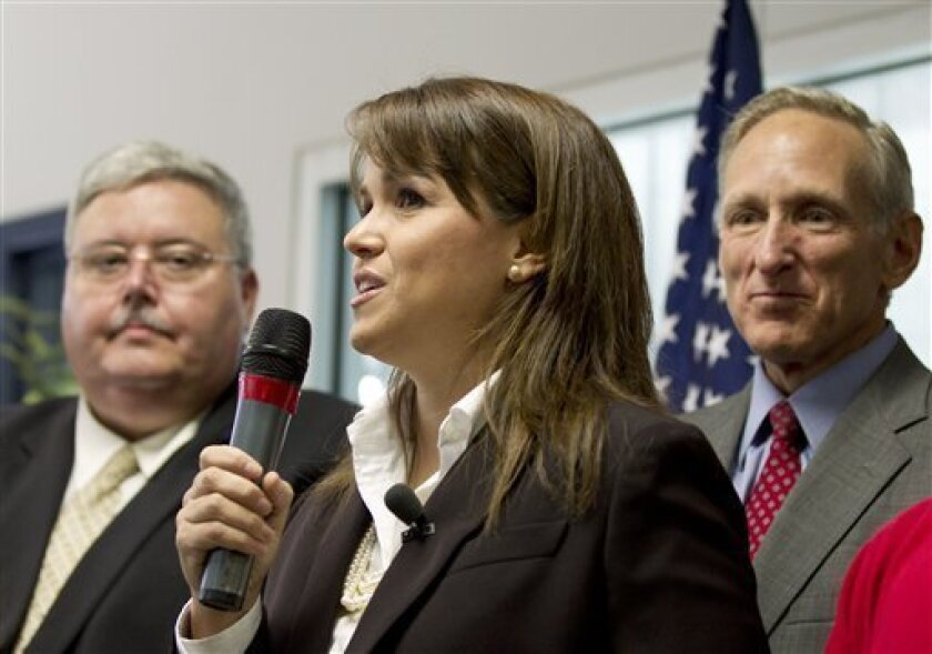 Delaware Republican Senate candidate Christine O'Donnell addresses supporters during a rally, Friday, Oct. 1, 2010, at her new campaign headquarters in Wilmington, Del. (AP Photo/Rob Carr)