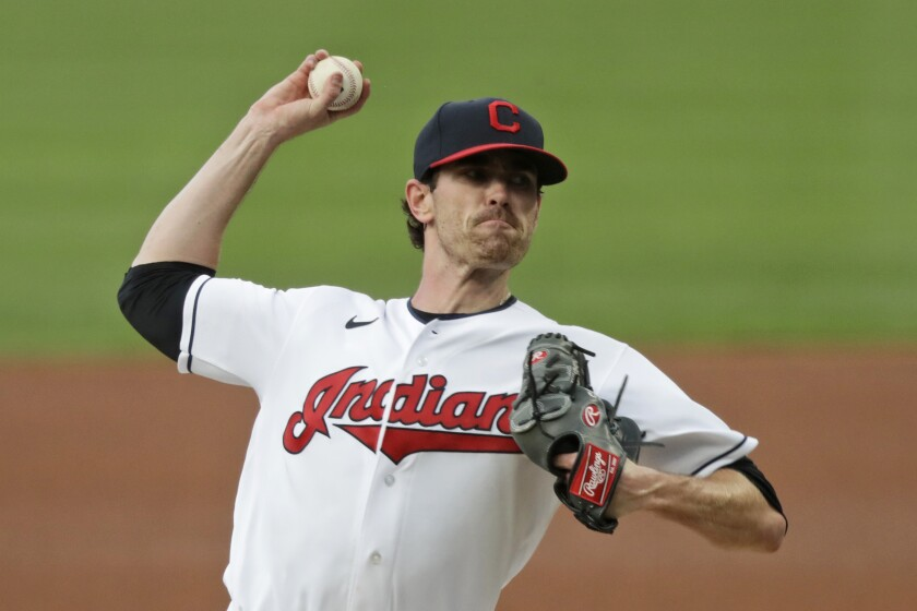 FILE - Cleveland Indians starting pitcher Shane Bieber delivers in the first inning in a baseball game against the Minnesota Twins in Cleveland, in this Tuesday, Aug. 25, 2020, file photo. For the Indians, the changes go beyond just dropping their debated name. (AP Photo/Tony Dejak, File)