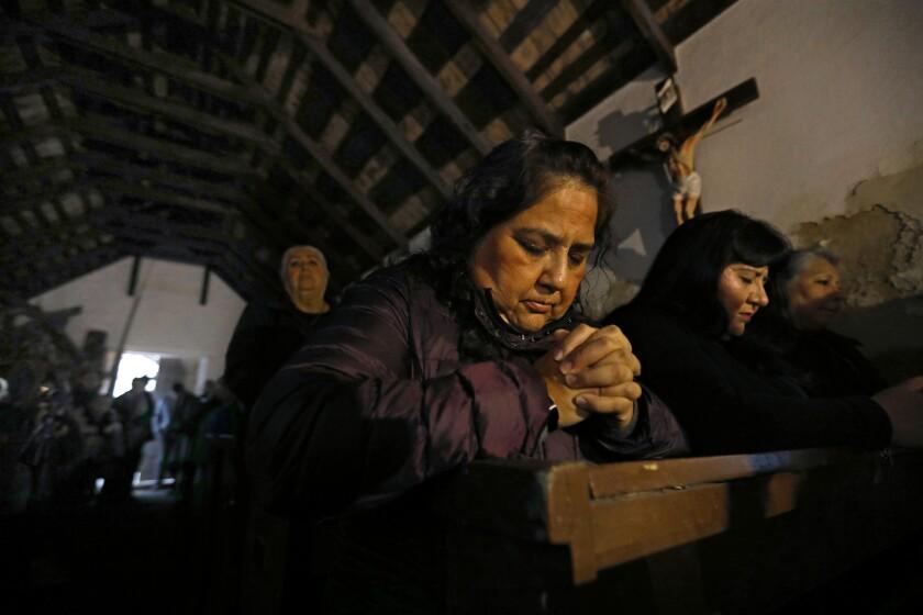 MISSION, TEXAS--FEB. 8, 2019--Elizabeth Garcia, center, and Anna Velasquez, right, pray during mass