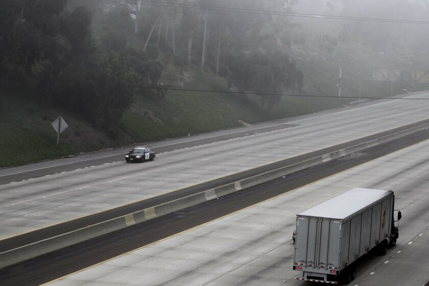 A Highway Patrol unit cruised the shut-down lanes of northbound I-805 through North Park just before it was reopened it to traffic after a lengthy closure due to a chain reaction crash.