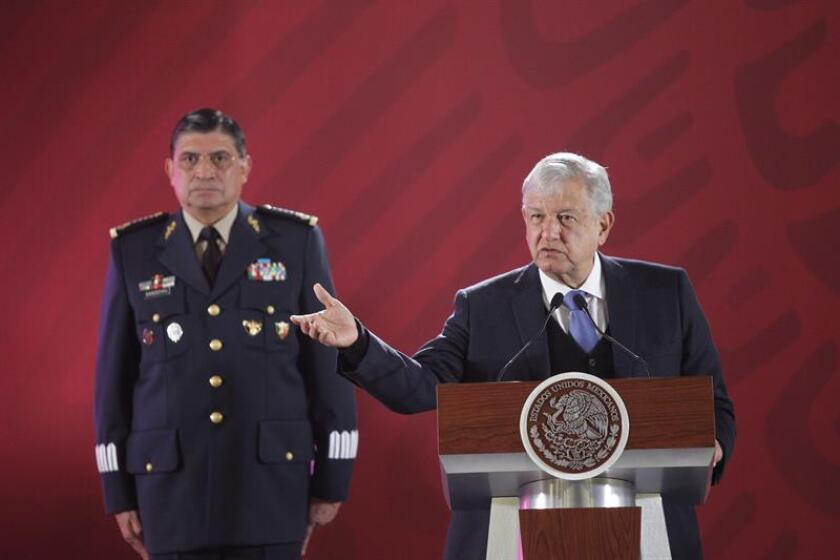 Mexican President Andres Manuel Lopez Obrador (R) speaks during his first press meeting of the year at the National Palace, in Mexico City, Mexico, on 2 January 2019. Lopez Obrador denied the rising of the number of murders during his first month of Government, acusing the newspaper Reforma of slander and make sensationalist journalism. EPA-EFE/Sashenka Gutierrez