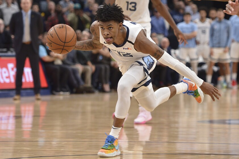 Memphis Grizzlies guard Ja Morant (12) handles the ball during the second half of the team's NBA basketball game against the Minnesota Timberwolves on Tuesday, Jan. 7, 2020, in Memphis, Tenn. (AP Photo/Brandon Dill)
