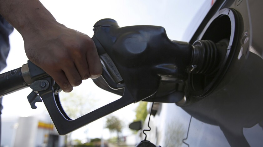 FILE - In this April 23, 2019, file photo, a motorist puts gas in his car at a Shell station in Sacr