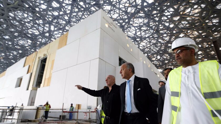 French Foreign Minister Laurent Fabius, center, and architect Jean Nouvel, left, visit the under-construction Louvre in Abu Dhabi in January.