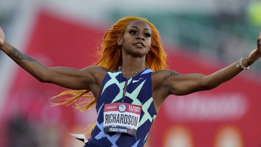 Sha'Carri Richardson celebrates after winning her heat of the women's 100 meters run at the U.S. Olympic trials last month