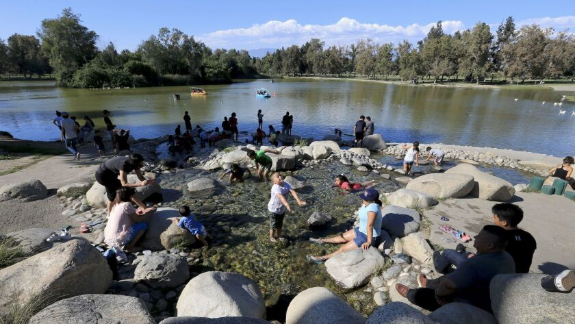 Kids play in the water at Whittier Narrows Recreation Area.
