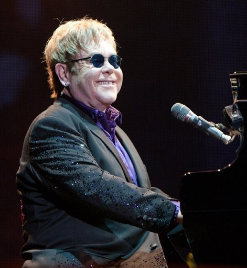 British singer Elton John performs in concert at the Ricardo Saprissa stadium in San Jose, Costa Rica, Friday Feb. 3, 2012. This is the first time Elton John performs in Costa Rica. (AP Photo/Ronald Reyes)
